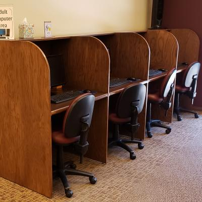 Carrels against wall