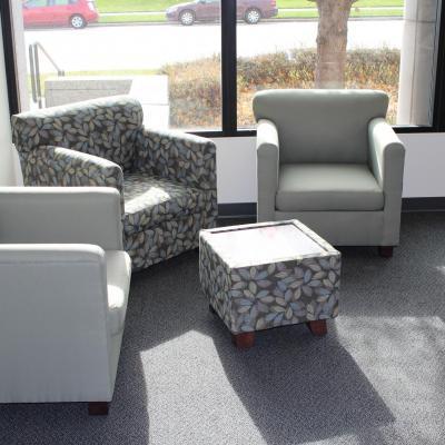 three lexington chairs and an ottoman
