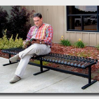 person siting on metal bench
