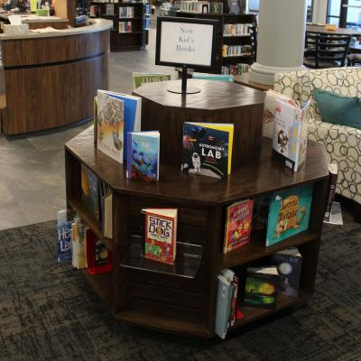A two level octagon shaped display and bookcase