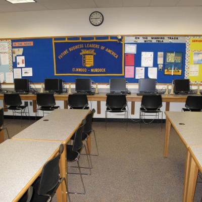 4 leg rectangular tables in series in a classroom