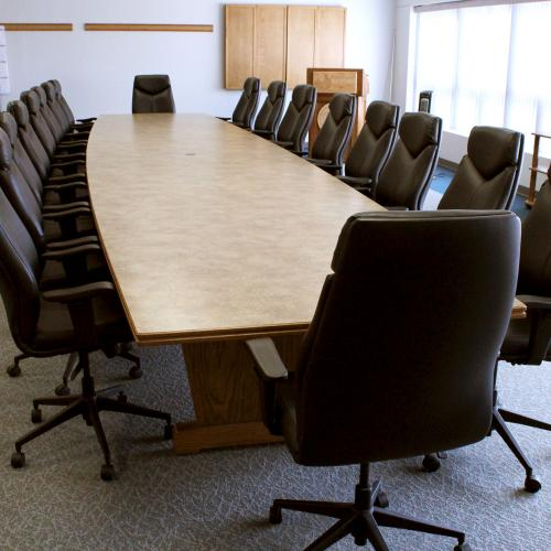 CSI Conference room with conference table and Delta chairs
