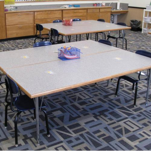 adjustable leg tables and student chairs in a classroom