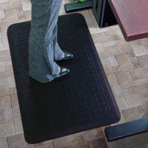 person standing on anti-fatigue mat