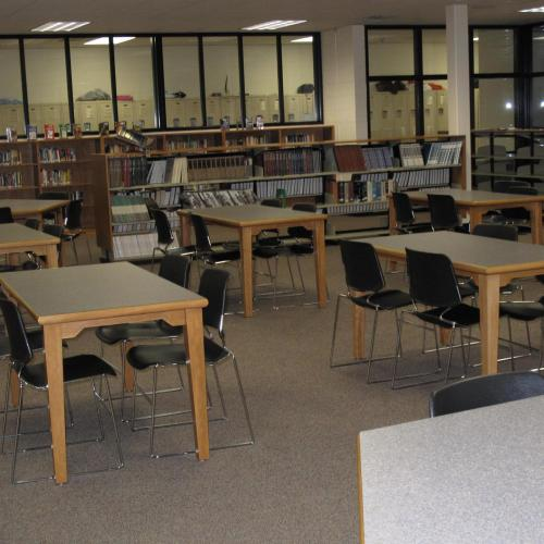 4 leg rectangular tables and chairs in a library