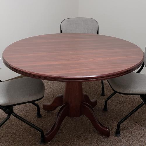 round conference table with 3 navigator chairs